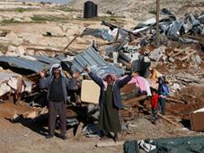 Palestinian Bedouin men react amidst the rubble of a structure after it was razed by the Israeli army in the West Bank village of Zayem, near Jerusalem November 29, 2011 (AFP Photo / Ahmad Gharabli)