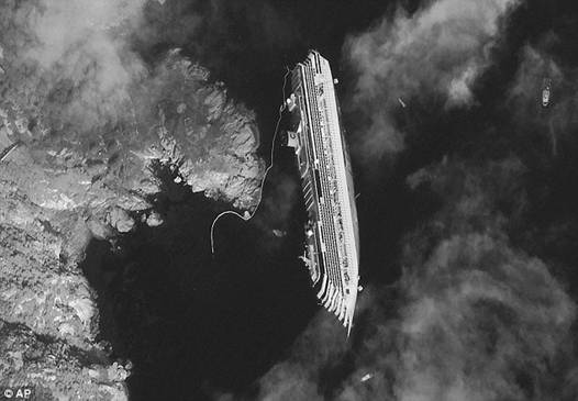 Impact: A satellite image shows the stricken cruise liner on its side in shallow water